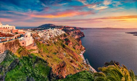 Magnificent morning view of Santorini island. Fantastic summer sunrise onfamous Greek resort Fira, Greece, Europe. Wonderful Mediterranean seascape. Traveling concept background.
