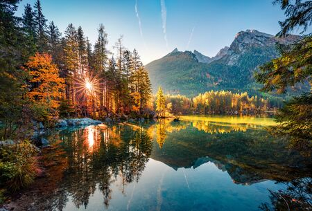 Majestic autumn view of Hintersee lake with Hochkalter peak on background, Germany, Europe. Gorgeous morning view of Bavarian Alps. Beauty of nature concept background.