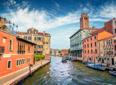 Attractive summer cityscape of Vennice with famous water canal and colorful houses. Splendid morning scene of Italy, Europe. Nice Mediterranean seascape. Traveling concept background.