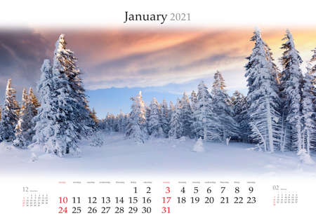 Calendar January 2021, B3 size. Set of calendars with amazing landscapes. Wonderful winter view of snowy forest on sunrise. Carpathian mountains after huge snowfall. Reklamní fotografie