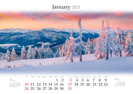 Calendar January 2021, B3 size. Set of calendars with amazing landscapes. Majestic winter scene of snowy forest on sunrise. Carpathian mountains after huge snowfall. Reklamní fotografie
