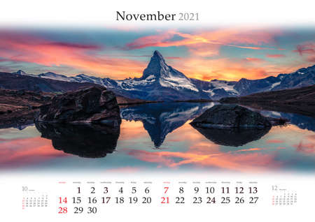 Calendar November 2021, B3 size. Set of calendars with amazing landscapes. Dramatic morning view of Stellisee lake with Matterhorn (Cervino) peak on background, Zermatt location, Switzerland