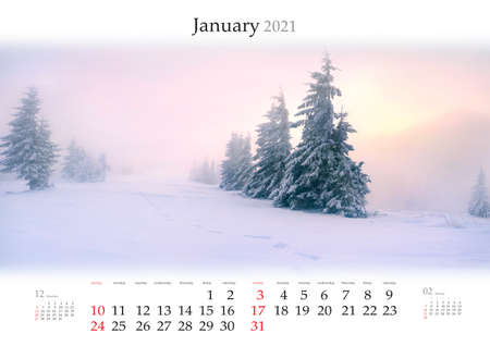 Calendar January 2021, B3 size. Set of calendars with amazing landscapes. Fantastic winter view of snowy forest on sunrise. Carpathian mountains after huge snowfall. Reklamní fotografie