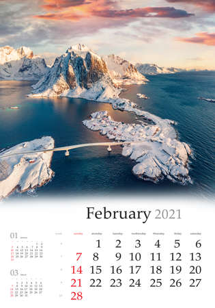 Calendar February 2021, vertical B3 size. Set of calendars with amazing landscapes. Exotic morning view from flying drone of Hamnoy port with Festhaeltinden mount on background, Norway.