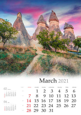 Calendar March 2021, vertical B3 size. Set of calendars with amazing landscapes. Magnificent fungous forms of sandstone in canyon near Cavusin village, Cappadocia, Turkey, Asia.
