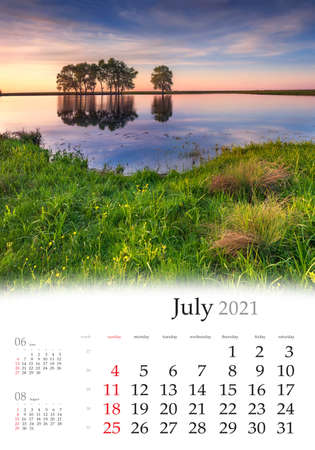 Calendar July 2021, vertical B3 size. Set of calendars with amazing landscapes. Impressive morning view of trees reflected in the calm waters of small lake. Summer scene of Ukraine, Europe.