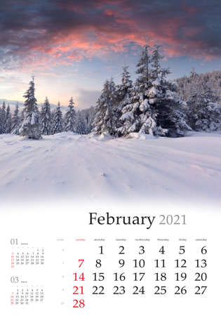 Calendar February 2021, vertical B3 size. Set of calendars with amazing landscapes. Impressive winter view of mountain forest. Fabulous sunrise in Carpathian mountains, Ukraine, Europe.