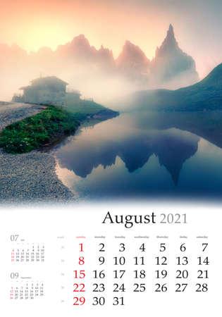 Calendar August 2021, vertical B3 size. Set of calendars with amazing landscapes. Impressive morning view of Baita Segantini mountain refuge with Cimon della Pala peak, Dolomiti Alps, Italy, Europe.