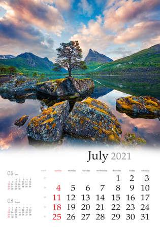Calendar July 2021, vertical B3 size. Set of calendars with amazing landscapes. Wonderful summer sunrise on the Innerdalsvatna lake. Impressive morning scene in Norway, Europe.