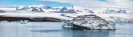 Floating of blue icebergs in Jokulsarlon Glacier Lagoon. Cold morning panorama of Vatnajokull National Park. Picturesque scene of Iceland, Europe. Beauty of nature concept background. Stok Fotoğraf