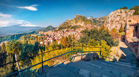 Captivatin summer view of Taormina town and Etna volcano on background. Beautiful world of Mediterranean countrys. Splendid morning scene of Sicily, Italy, Europe. Stock fotó