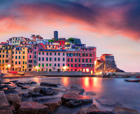 Calm dawn cityscape of Vernazza port. Exciting summer sunrise on Liguria, Cinque Terre, Italy, Europe. Dramatic seascape of Mediterranean sea. Traveling concept background.