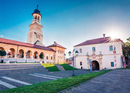 Sunny summer view of Coronation Orthodox Cathedral in Fortress Of Alba Iulia. Stunning morning scene of Transylvania, Iulia Alba city, Romania, Europe. Traveling concept background.