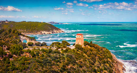Stormy wether in Gargano National Park. Beautiful summer view of Torre di San Felice tower in Apulia region, Italy, Europe. Morning seascape of Adriatic sea. Traveling concept background.