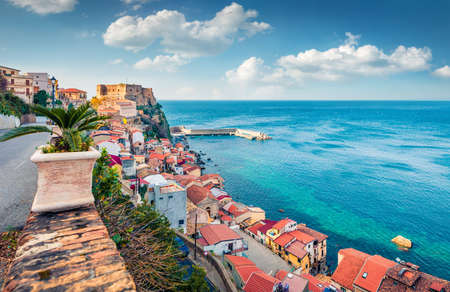 Wonderful afternoon view of Scilla town with Ruffo castle on background, administratively part of the Metropolitan City of Reggio Calabria, Italy, Europe. Sunny spring seascape of Mediterranean sea.