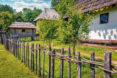 Captivating summer view of traditional romanian peasant houses. Amazing rural scene of Transylvania, Romania, Europe. Beauty of countryside concept background.