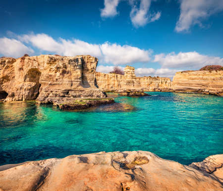 Incredible summer view of popular tourist attraction - Torre Sant'Andrea. Exotic morning seascape of Adriatic sea, Torre Sant'Andrea village location, Apulia region, Italy, Europe. Foto de archivo
