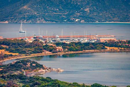 Beautiful morning view of Villasimius port. Splendid spring scene of Sardinia island, Italy, Europe. Captivating seascape of Mediterranean sea. Traveling concept background.