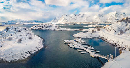View from flying drone of Finnhamnen small fishing port, Norway, Europe. Bright morning scene of Lofoten Islands archipelago. Untouched winter landscape. Life over polar circle.