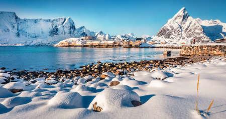 Astonishing afternoon scene of Sakrisoy village, Norway, Europe. Amazing winter view of Lofoten Islads. Beautiful seascape of Norwegian sea. Traveling concept background. Untouched winter landscape.
