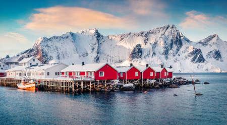 Captivating winter cityscape of small fishing town - Hamnoy, Norway, Europe. Stunning morning seascape of Norwegian sea. Iconic landscape of Lofoten Island. Life over polar circle.