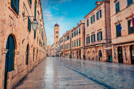 Empty street of Dubrovnik. Early morning view of Cathedral. Splendid summer cityscape of Old Town of Dubrovnik, Croatia, Europe. Beautiful world of Mediterranean countries.