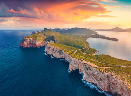 Fabulous morning view from flying drone of Caccia cape. Aerial spring scene of Sardinia island, Italy, Europe. Amazing seascape of Mediterranean sea. Beauty of nature concept background. 免版税图像