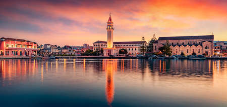 Panoramic evening view of Zakynthos town with Saint Dionysios Church, Zakynthos island, Greece, Europe. Unbelievable summer sunset on Mediterranean sea. Ionian Sea, Traveling concept background.