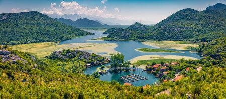 Panoramic view of Rijeka Crnojevica river, Skadar lake location. Attractive summer scene of Karuc village, Montenegro, Europe. Beautiful world of Mediterranean countries.