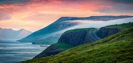 Panoramic summer view of Streymoy Island. Great sunrise on outskirts of Kirkjubour village, Faroe Islands, Kingdom of Denmark, Europe. Beauty of nature concept background. 免版税图像