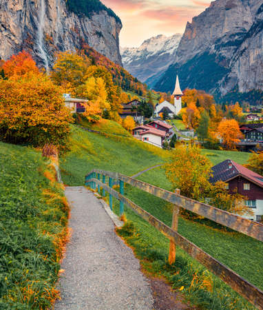Incredible autumn view of great waterfall in Lauterbrunnen village. Majestic outdoor scene in Swiss Alps, Bernese Oberland in the canton of Bern, Switzerland. Traveling concept background.