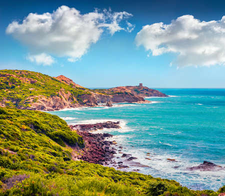 Incredible summer view of Torre Argentina tower. Gorgeous morning scene of Sardinia island, Italy, Europe. Attractive seascape of Mediterranean sea. Beauty of nature concept background. 免版税图像