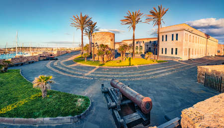 Captivating morning cityscape of Alghero town, Province of Sassari, Italy, Europe. Picturesque summer scene of Sardinia island, Mediterranean seascape. Traveling concept background.