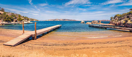 Panoramic morning view of public beach of Rafael port, Province of Olbia-Tempio, Italy, Europe. Warm summer day on Sardinia. Nice seascape om Mediterranean sea. Traveling concept background.