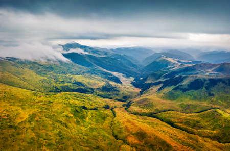 Dramatic summer scene of Svydovets mountain range with Blyznytsi peak on background. Stunning morning view of misty Carpathian mountains, Ukraine, Europe. 免版税图像