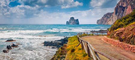 Panoramic summer view of popular tourist destination - Concali Su Terrainu with Porto Corallo on background. Sunny morning scene of Sardinia island, Italy, Europe. Mediterranean seascape.
