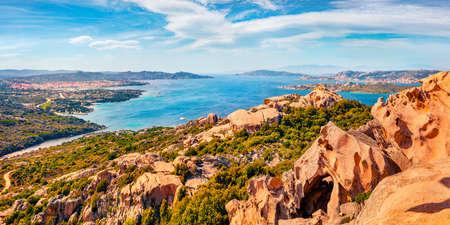 Panoramic spring cityscape of Palau port, Province of Olbia-Tempio, Italy, Europe. View from popular tourist destination - Rock of the Bear. Sunny morning scene of Sardinia island. Mediterranean seascape.