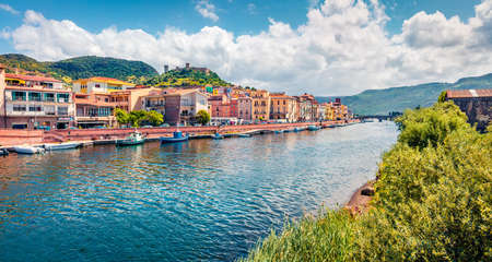Panoramic spring cityscape of Bosa town with Ponte Vecchio bridge across the Temo river. Spectacular morning view of Sardinia island, Italy, Europe. Traveling concept background.