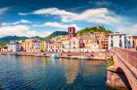 Impressive summer cityscape of Bosa town with Ponte Vecchio bridge across the Temo river. Marvelous morning view of Sardinia island, Italy, Europe. Traveling concept background.