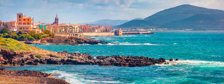 Panoramic summer cityscape of Alghero town. Sunny morning scene of Sardinia island, Italy, Europe. Beautiful Mediterranean seascape. Traveling concept background.