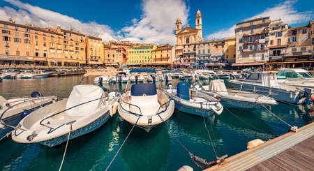 Attractive summer cityscape of Bastia port with twin-towered Church of St. Jean-Baptiste rising behind it. Splendid morning view of Corsica island, France, Europe. Beautiful Mediterranean seascape. 新闻类图片