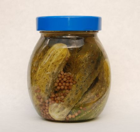 A jar of home made pickled gherkins with dill and coriander seeds Stock Photo - 3779071
