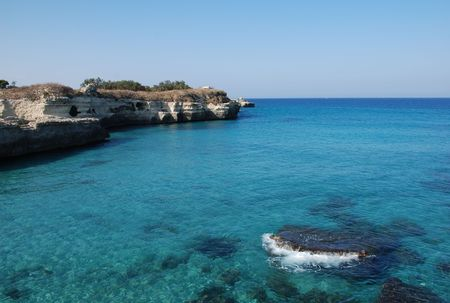 southern europe: A beautiful stretch of rocky coastline with clear blue waters in Puglia, southern Italy. The area is known by locals as The Poetry.  Stock Photo