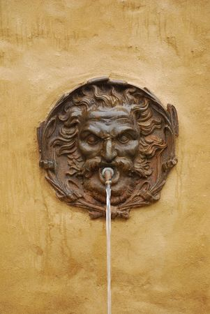 A fountain issues water in the Tuscan town of Pitigliano  Reklamní fotografie
