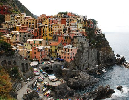 Manarola, one of the towns of the Cinque Terre in Liguria, Italy, which are perched precariously on the steep coast  Stock Photo