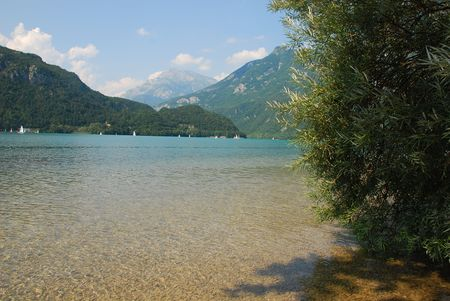 The shallow waters near the shore at Lago Cavazzo in Carnia, Italy