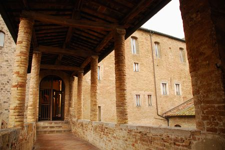 A covered walkway in old brick building in the historic Tuscan hill town of San Gimignano  Stock Photo - 3802569