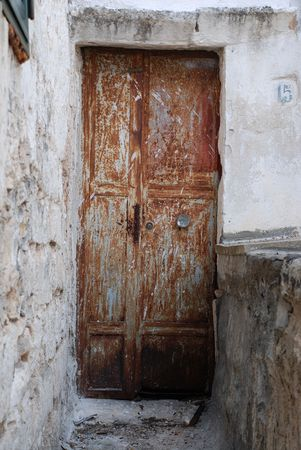 unkempt: An old brown metal door in Ostuni (The White City)