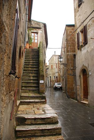 narrow: A street in the historic Tuscan town of Pitigliano, Italy