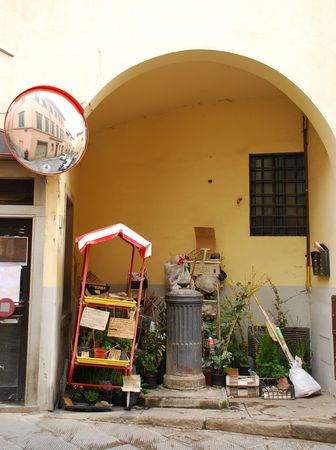 unattended: A small unattended plant vendors cart in a Tuscan street
